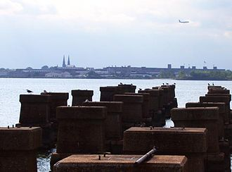 Newark Bay - The CRRNJ Newark Bay Bridge, demolished in the 1980s, crossed to Elizabethport, seen in the distance.