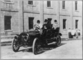 Enrico Caruso seated in automobile with 4 other men.png