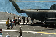 Evacuees from Naval Station Subic Bay boarding an HMH-772 CH-53 on the USS Midway