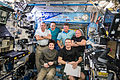 Expedition 43 crewmembers in the Destiny lab.jpg