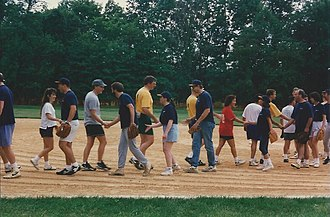 Handshakes at the conclusion of a championship game in a co-ed recreational league, as seen in New Jersey in 1997 Exxon Intramural Softball League - SU&P vs Defectors - Field 2 - handshakes after Championship Game - 12 Aug 1997.jpg