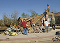 FEMA - 40846 - Homeowner and volunteers assess the damage to his home in Arkansas.jpg