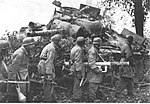 Fallschirmjäger soldiers and destroyed M4A3 Sherman tank, 1944.jpg
