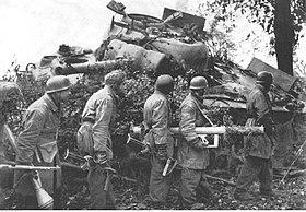 Fallschirmjäger soldiers and destroyed M4A3 Sherman tank, 1944.jpg