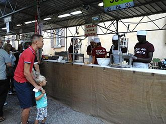 Immigration to Italy - Senegalese workers at the Potato festival in Vimercate (Lombardy) in 2015