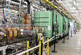 Facility for Rare Isotope Beams - On 11-12 July 2018, the Facility for Rare Isotope Beams accelerated first beam in three of forty-six superconducting cryomodules (painted green). Beam in the warm radio-frequency quadrupole was previously accelerated in September 2017.