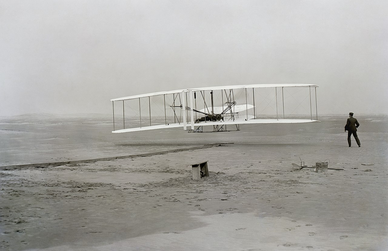 First successful flight of the Wright Flyer by the Wright brothers.