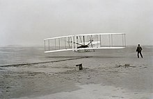 First Flight of the Wright Flyer I December 17 1903, Orville is the pilot, Wilbur along side