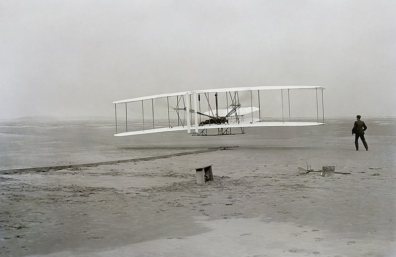 Photo of the first successful flight of the Wright Flyer, by the Wright brothers.