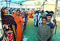 First time voters (under the India-Bangladesh Land Boundary Agreement) standing in queue to cast their votes, at a polling booth, during the sixth phase of West Bengal Assembly Election, at Dinhata constituency.jpg
