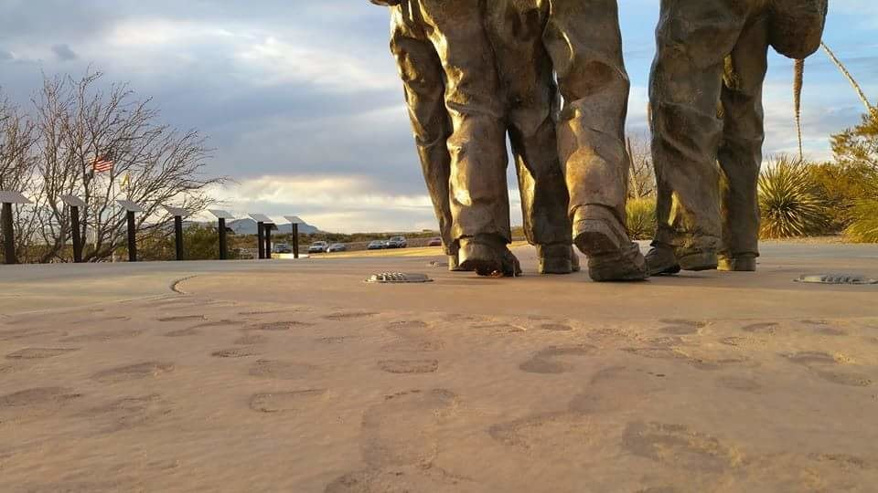 Footprints of survivors leading to statue