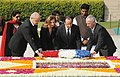 Francois Hollande and Ms. Valerie Trierweiler laying wreath at the Samadhi of Mahatma Gandhi, at Rajghat, in New Delhi on February 14, 2013. The Minister of State for External Affairs, Smt. Preneet Kaur is also seen.jpg
