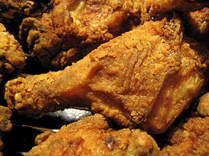 Several pieces of fried chicken.