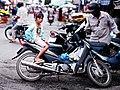 Girl on a bike near Mekong Delta, Vietnam - panoramio.jpg