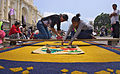 Girls preparing sawdust carpet for Semana Santa in Antigua, Guatemala.jpg