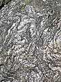 Gneiss (Archean; Norris South roadcut, Madison County, Montana, USA) 5 (44803634414).jpg