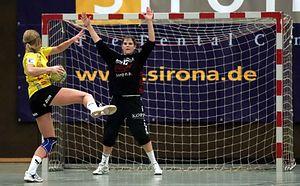 Handball goalkeeper - A woman goalkeeper during a seven-meter throw