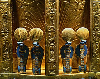 Uraeus - Four golden uraei cobra figures on the reverse side of the throne of Pharaoh Tutankhamun (1346-1337 BC). Valley of the Kings, Thebes, New Kingdom (18th dynasty)