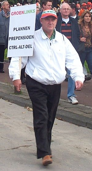"Control-Alt-Delete - Dutch protester carrying a sign that reads ""Ctrl-Alt-Del the early retirement plan"""
