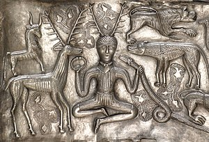 Celtic deities - Detail of the antlered figure holding a torc and a ram-headed snake depicted on the 1st or 2nd century BCE Gundestrup cauldron discovered in Jutland, Denmark.