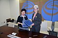 HHS Secretary Sebelius and WHO Director-General Margaret Chan pose with a recently signed Memorandum of Understanding between the U.S. Government and the World Health Organization.jpg