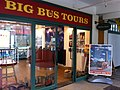 HK Central Piers Clock Tower shop Big Bus Tours buy ticket here Dec-2012.JPG