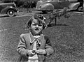Half-length portrait of a young girl standing outside on a lawn (AM 75020-1).jpg