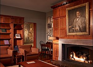 Cliff Dwellers Club - Photo of Cliff Dwellers fireplace and lounge area with portrait of Hamlin Garland, first president of the Club.