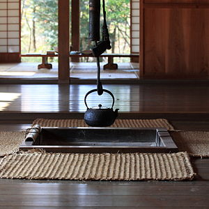 Tetsubin - A tetsubin cast-iron kettle is suspended over an irori hearth in a traditional Japanese style farm house, at the Boso-no-Mura Museum