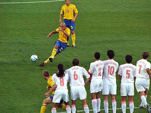 Sweden's Henrik Larsson taking a free kick against the Netherlands in the UEFA Euro 2004 quarter-finals.