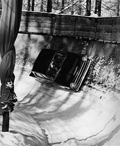 Henry Taylor driving a Ford Cortina down the bobsleigh run at Cortina d'Ampezzo.jpg