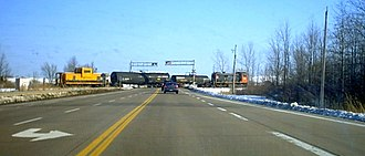 Ontario Highway 406 - Highway 406 once featured the only at-grade railway crossing of any 400-series highway. This section was not a proper freeway, but rather a Super two. This crossing was later eliminated and grade separated in 2014 when the route was finally upgraded to freeway standards.