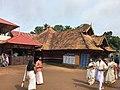 Hindus in traditional dress at the Mahadeva Temple, Ettumanoor Kerala.jpg