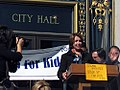 """House Democratic Leader Nancy Pelosi at podium during """"Speak Up for Kids Day"""" rally on March 31, 2005.jpg"""
