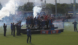 Terry Butcher - The Inverness team celebrate winning the First Division title in May 2010 at the Caledonian Stadium (Butcher is to the left of the stage)