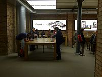 An Apple Store with people trying out the iPhone 4S