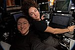 ISS-61 Christina Koch and Jessica Meir practice robotics techniques inside the Cupola.jpg