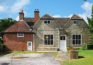 Ifield Friends Meeting House - The restored south-eastern elevation: note the repointing.  The meeting house is on the right and 5 Langley Lane is on the left.