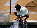 India - Faces - Rural rice mill labourer washing up (2458850082).jpg