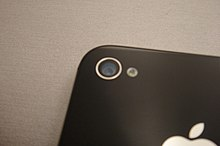 The camera on the back side of the iPhone 4S.