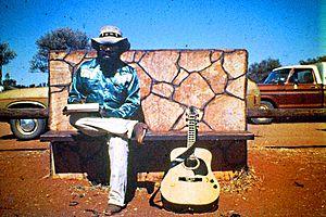 Isaac Yama outside Ininti Store, Uluru. 1983.JPG