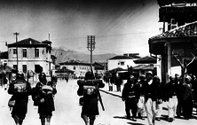 Italian soldiers passing Albanians, 7 April 1939