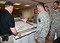 James Sweatman, the range and training land and integrated training area management officer, gives a demonstration on the production of maps to U.S. Soldiers assigned to the 509th Signal Battalion, at Caserma 130410-A-DO858-005.jpg
