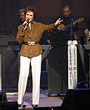 Jan Singing on the Opry in Brown Jacket.jpg