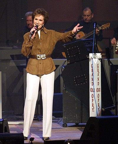 Howard on stage at the Opry, 2000s Jan Singing on the Opry in Brown Jacket.jpg