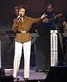Jan Singing on the Opry in Brown Jacket.jpg