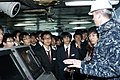 Japanese high school students listen as U.S. Navy Chief Mass Communication Specialist Ryan Delcore describes the navigation controls aboard the aircraft carrier USS George Washington (CVN 73) during a tour 130402-N-GC965-014.jpg