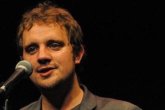 John Osborne (writer) - John Osborne performing at Howl, Poetry Link Chelmsford 2009. Image by Caroline Joy Watson
