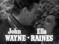 John Wayne and Ella Raines in Tall in the Saddle 2.png