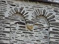 Jumilhac église clocher tête (6).JPG